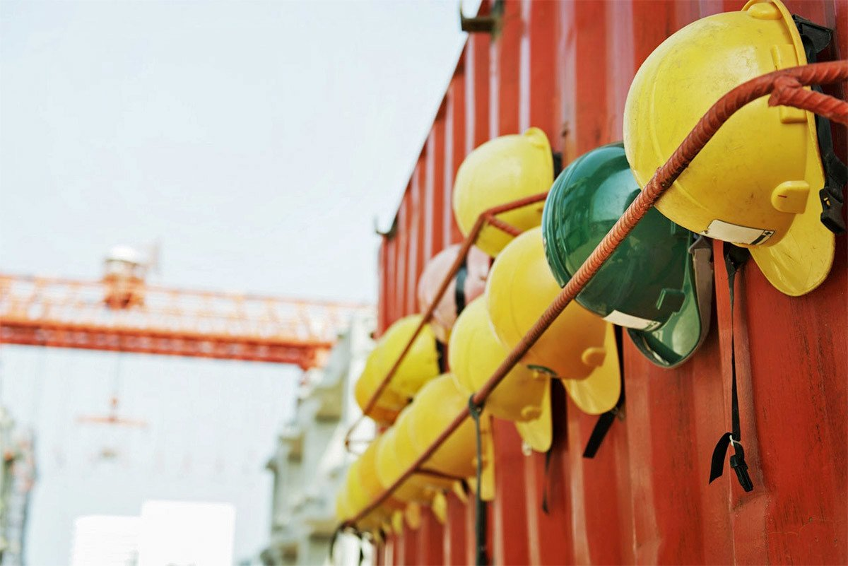 hardhats hanging on container