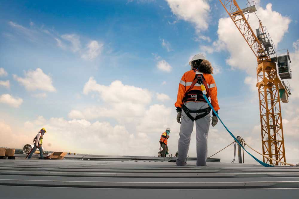 Worker harnessed to roof using Codesafe solutions